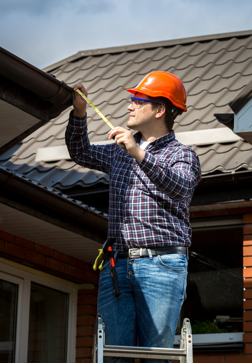 Measure and take thin hardboard to cut the replacement soffit.